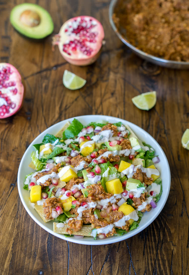 Vegan Chickpea Taco Salad with Pomegranate and Mango. Here are 25 delicious vegan salads that will fill you up and have a healthy source of protein. Show your friends that not 'all vegans eat is rabbit food' with these unique and delicious twists on salads #vegan
