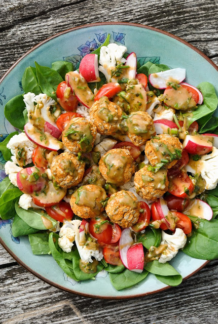 Vegan Fresh Salad With Baked Bean BAlls. Here are 25 delicious vegan salads that will fill you up andhave a healthy source of protein. Show your friends that not 'all vegans eat is rabbit food' with these unique and delicious twists on salads #vegan