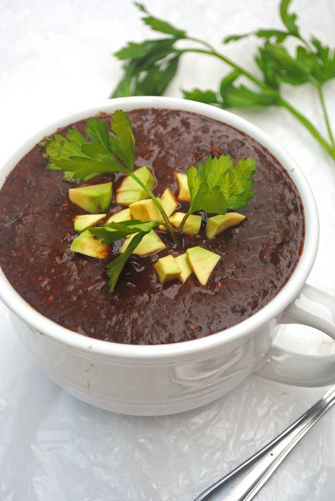 Vegan Slow Cooker Black Bean Soup.  Here are 17 amazing vegan crock pot recipes that you won't believe are even vegan.. #vegan #crockpot #vegancrockpot #foodanddrink #veganrecipes #slowcooker #dinner