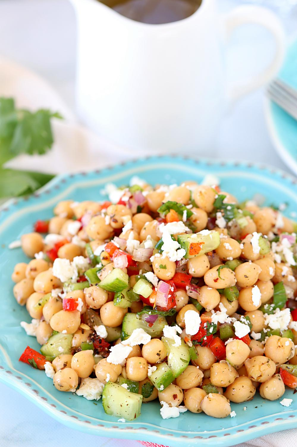 Vegan Chickpea Salad. Here are 25 delicious vegan salads that will fill you up and have a healthy source of protein. Show your friends that not 'all vegans eat is rabbit food' with these unique and delicious twists on salads #vegan