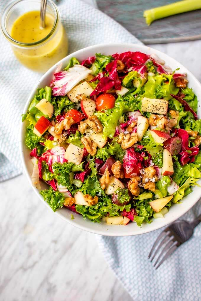 Vegan Kale Waldorf Salad. Here are 25 delicious vegan salads that will fill you up and have a healthy source of protein. Show your friends that not 'all vegans eat is rabbit food' with these unique and delicious twists on salads #vegan