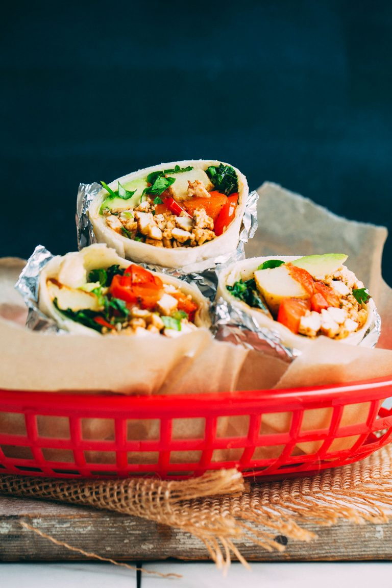 Vegan Scrambled Tofu Breakfast Burrito are a delicious and savory breakfast option for busy mornings. You can make them ahead and freeze for on the go. #vegan #protein