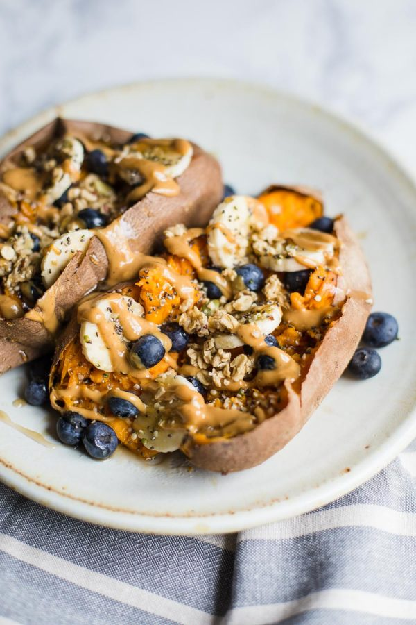 Loaded Breakfast Sweet Potatoes and 17 More Protein Packed Vegan Breakfast Ideas that are perfect for busy mornings and on the go. It's easy to eat clean and achieve your weight loss and fitness goals with these delicious recipes for your busy morning. From smoothies, tofu scrambles to overnight oats, you're sure to find something you love. #vegan #protein