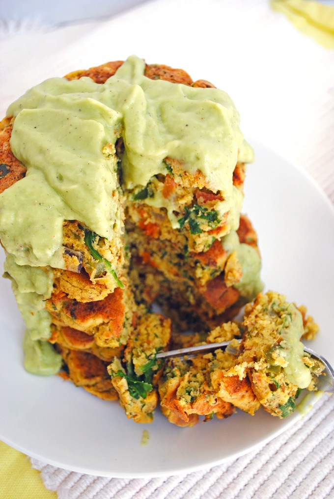 These Vegan Fluffy Chickpea Pancakes With Vegetables and Avocado Sauce are nutritious and delicious. Such a great way to egt your vegetables in the morning for breakfast. High in protein and naturally low-carb. #vegan #protein