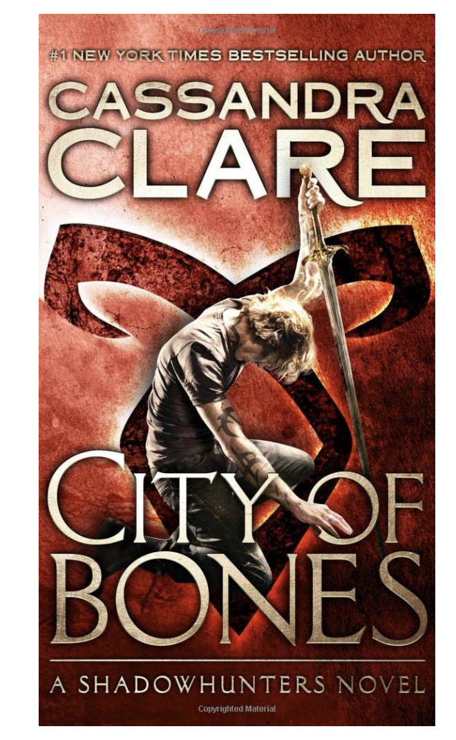 City of Bones by Cassandra Clare. 10 books as engaging as harry potter that you won't be able to put down! These books about magic and fantasy should be on your TBR stack as they are captivating and engaging. Absolute MUST READS! #books #bookstoread #reading