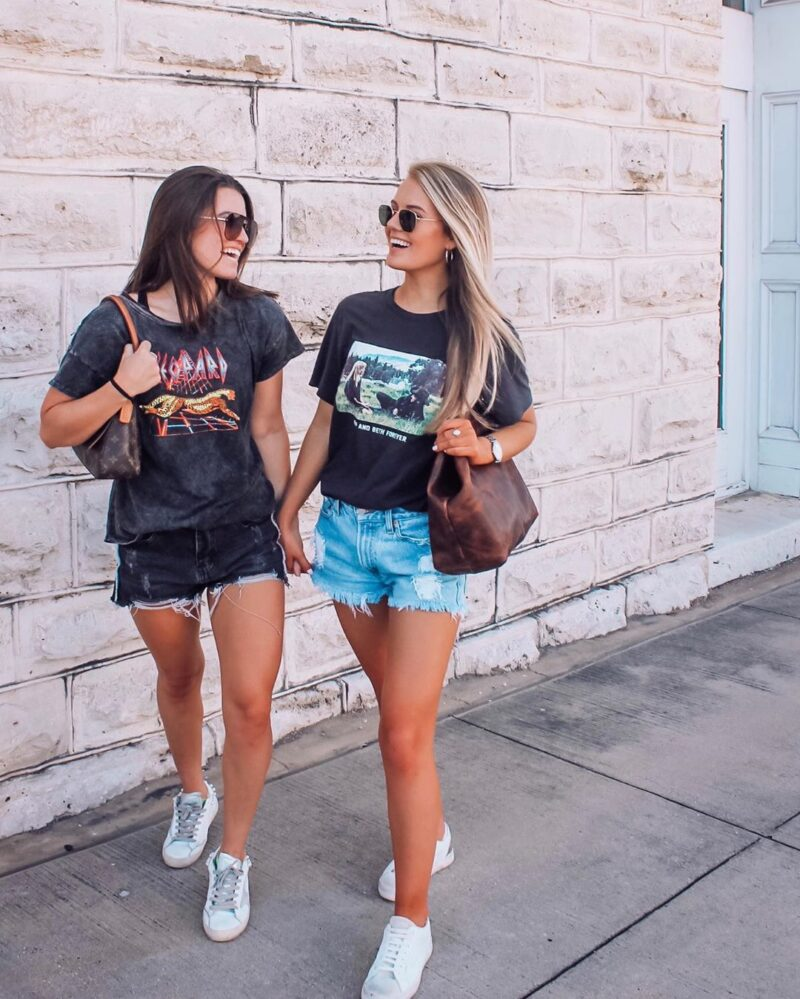 My favorite graphic tee's under $25! Doesn't matter if it's a lazy Saturday or a date night, you can style a graphic tee up or down! Style your graphic tee with shorts or a leather skirt for a fashionable look #graphictee #casualoutfits #lazysundayoutfit