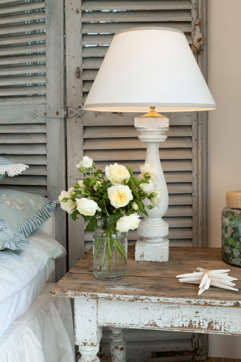 Old shutters used as a headboard. Cool way to decorate a bedroom on a budget