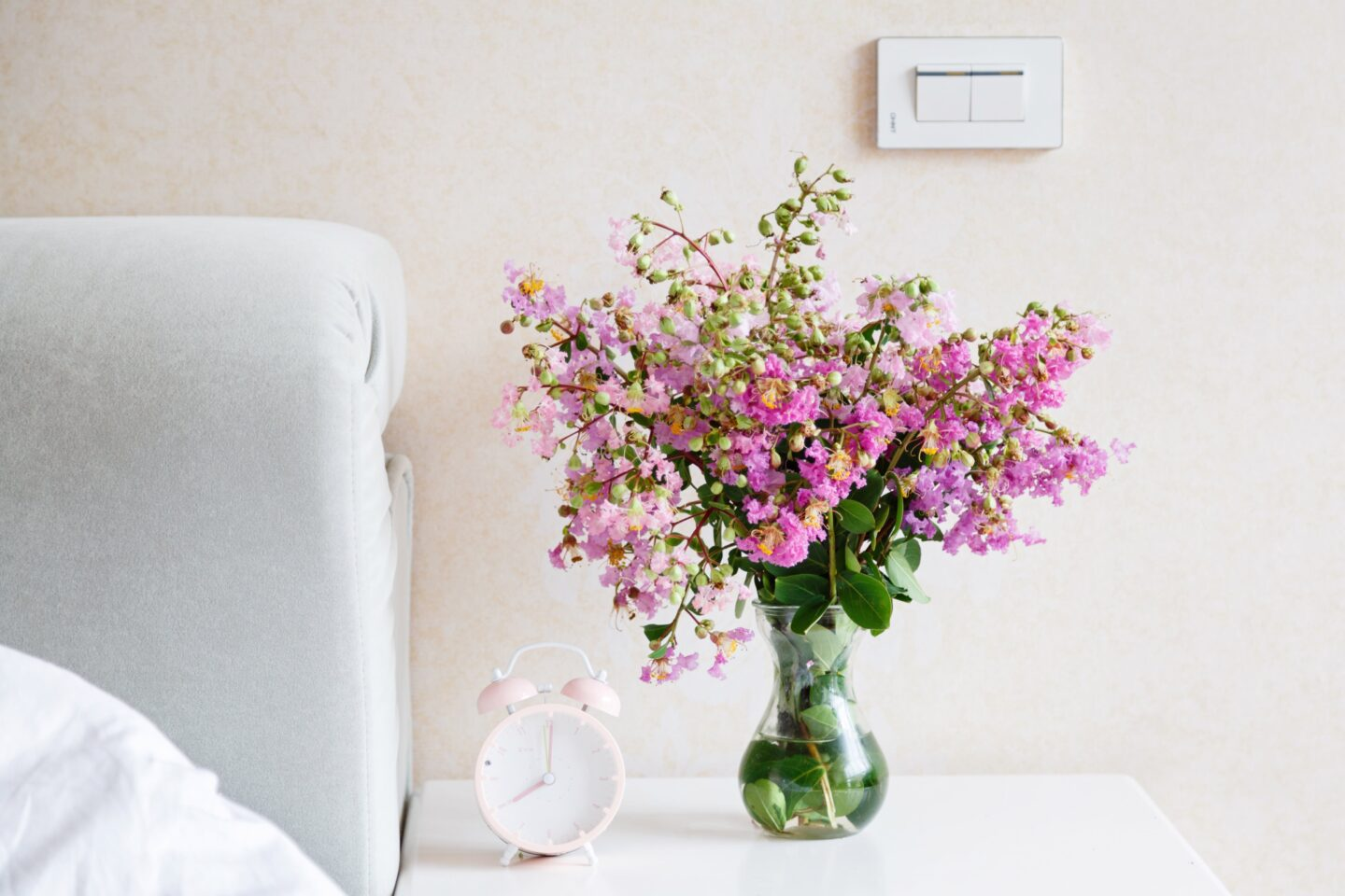 Fresh flowers on a nightstand are an easy and cheap home decor idea perfect for your bedroom.