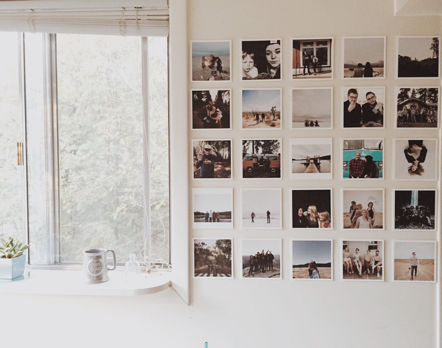 A photo wall is an easy and cheap way to decorate a bedroom