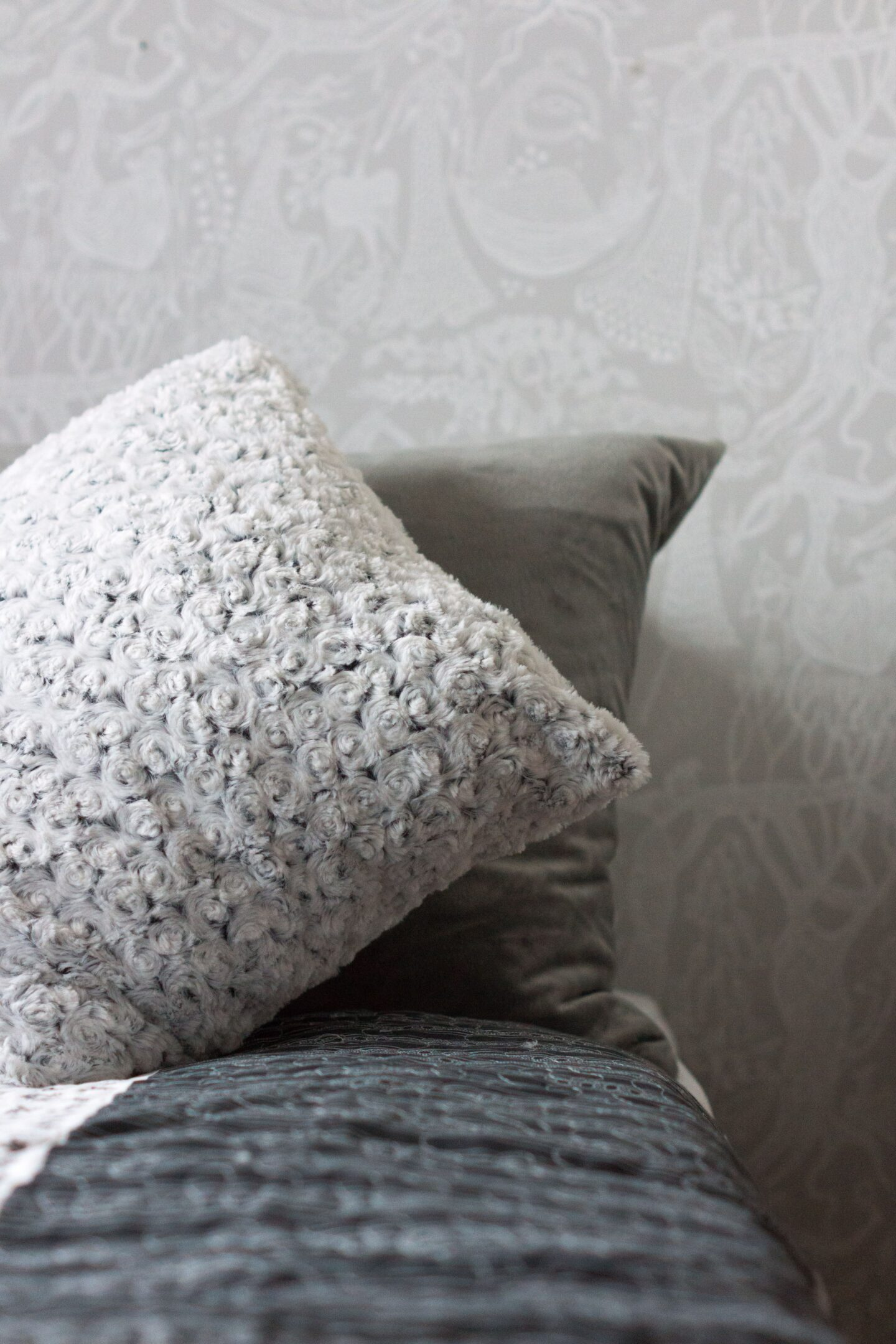 Wallpaper accent on a bedroom as a budget friendly way to decorate a room.