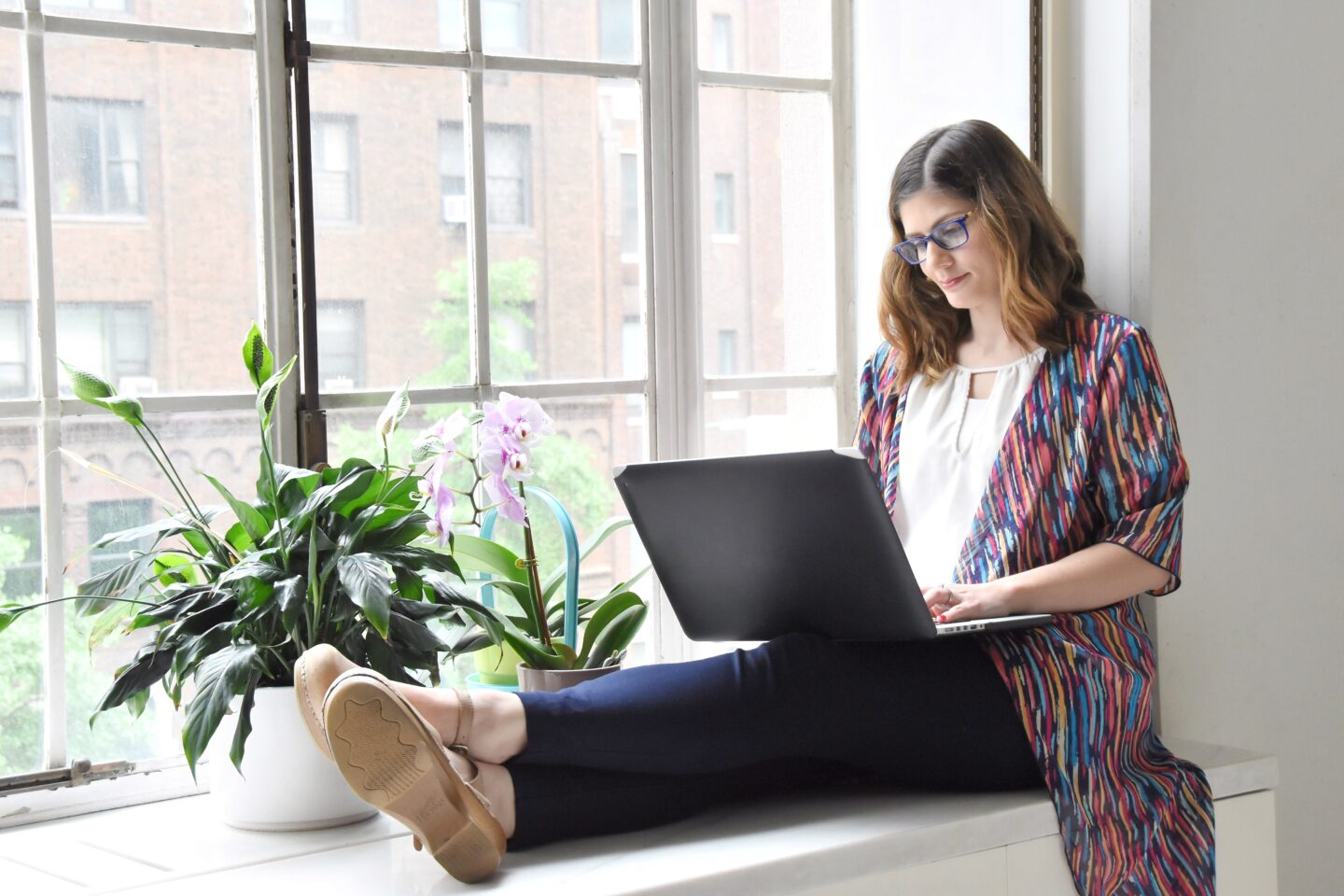 Working woman on her laptop for her new job