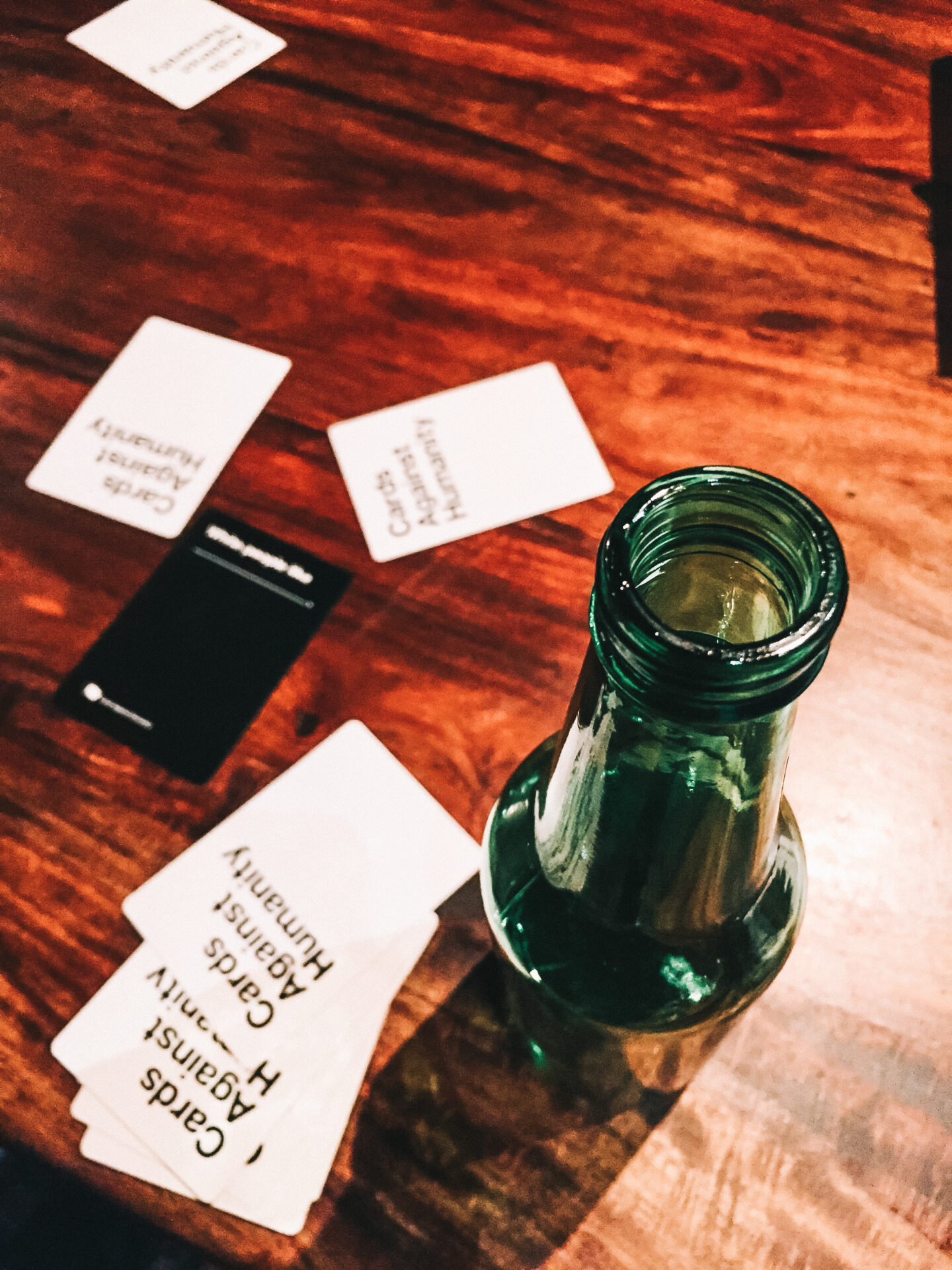 Playing games, like Cards Against Humanity, is a fun (and cheap!) way to host a party