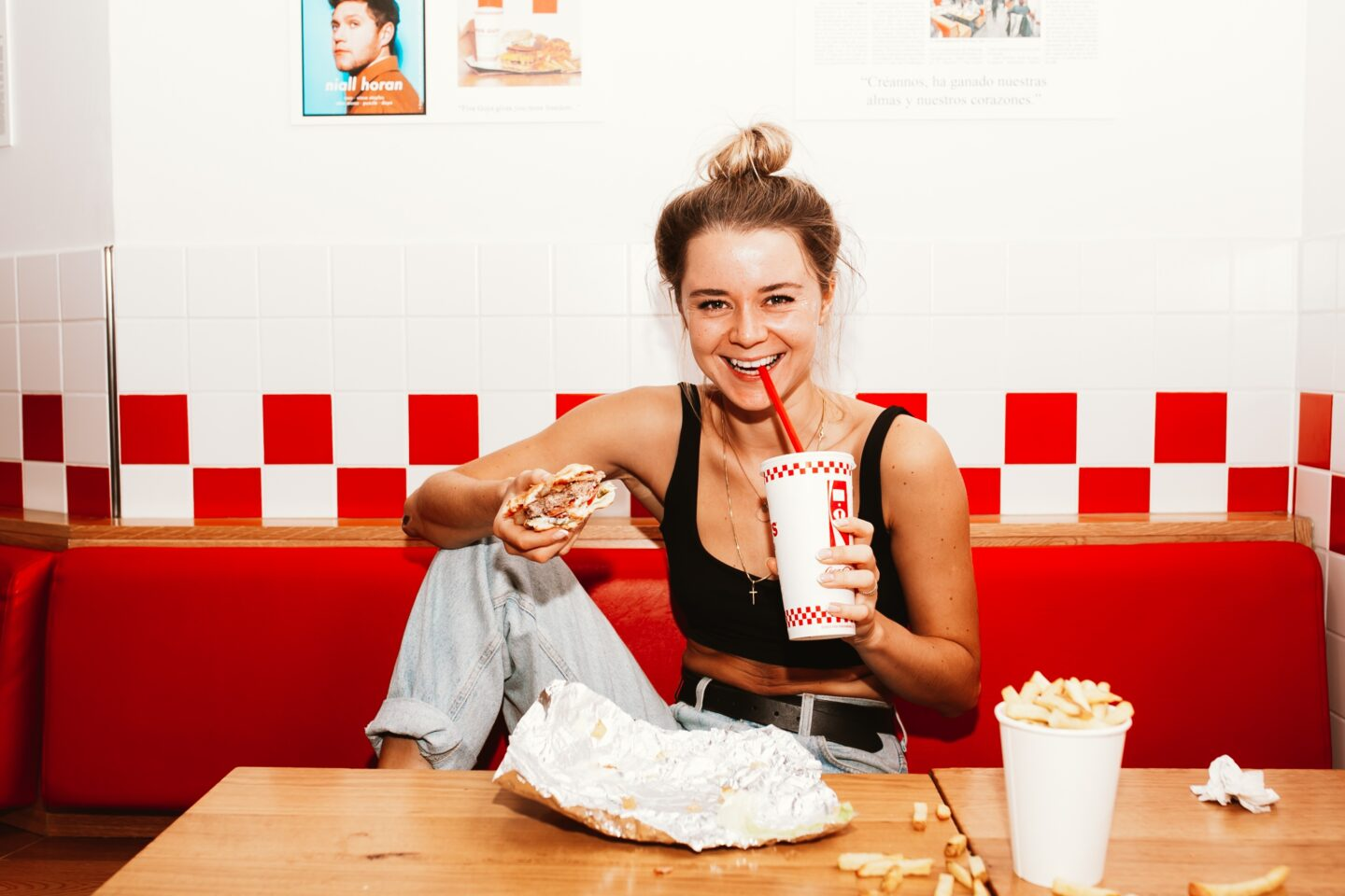Women eating a burger - naturally skinny women don't diet and enjoy a variety of foods